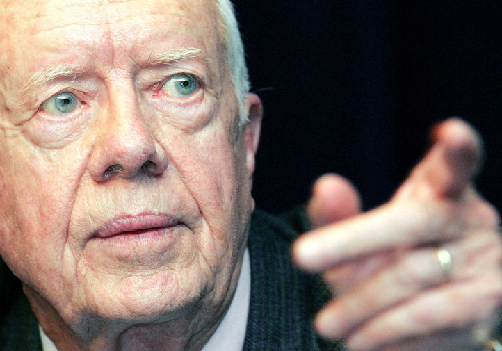 **FILE**Former President Jimmy Carter takes a question during a conference at The Carter Center in Atlanta, Tuesday, June 7, 2005. An independent panel Wednesday, Aug. 24, 2005 reversed a Pentagon recommendation that the New London submarine base in Connecticut, base be closed. One of the panel members even said a letter from Carter _ the only president to ever serve as a submariner _ pleading the panel to keep the base open was one of the reasons he voted against closure. (AP Photo/Ric Feld, File)