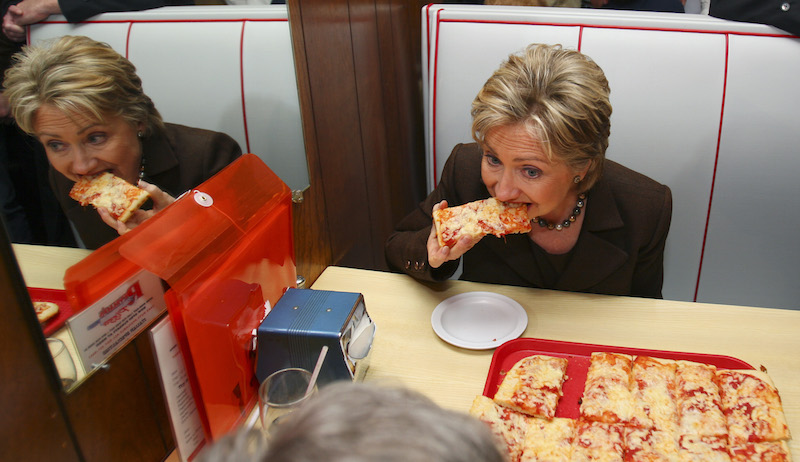 Democratic presidential hopeful, Sen. Hillary Rodham Clinton, D-N.Y., eats pizza during a lunch stop at Revello's Cafe Pizzeria, while campaigning in Old Forge, Penn., Monday, March 10, 2008. (AP Photo/Carolyn Kaster)