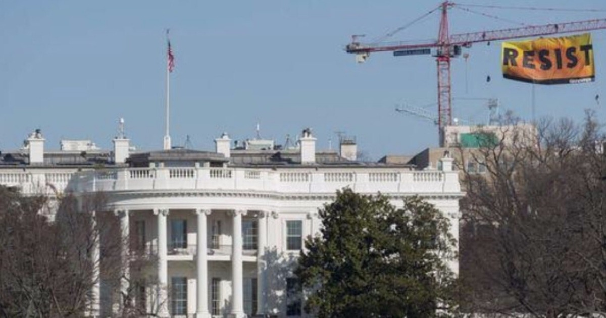 Protesters climb crane blocks from the White House